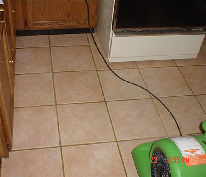 Tile floor in kitchen with green drying equipment set up and running.