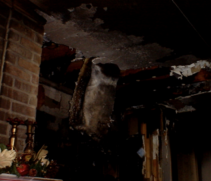 Fire damaged walls and ceiling.