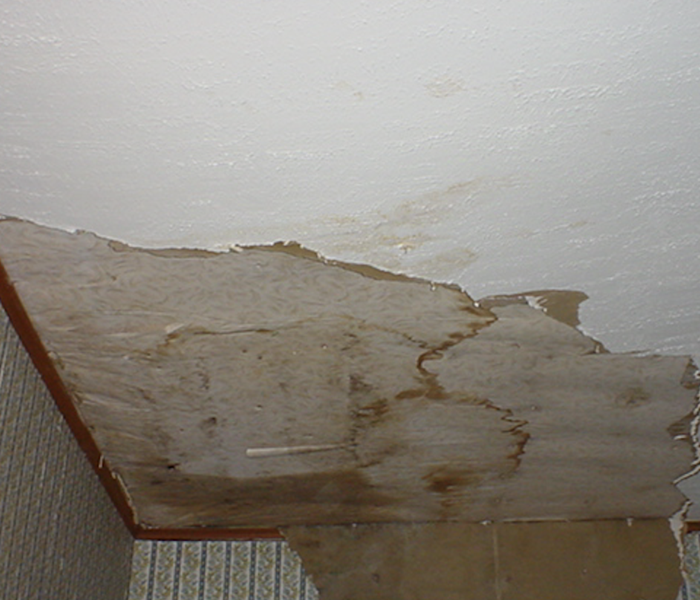 Water damaged ceiling in a home.