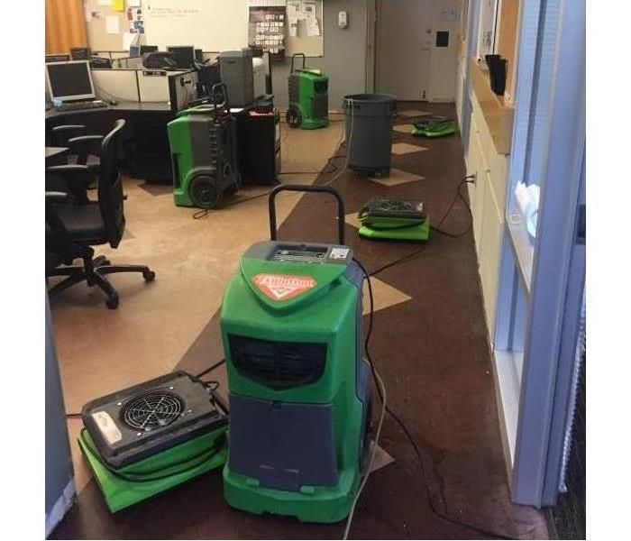 Six air movers placed in an office