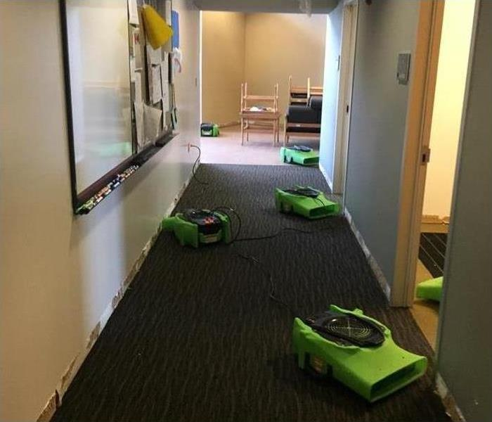 Five air movers placed on the hallway of a commercial building. Concept drying a commercial facily